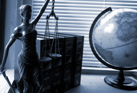 lady justice with law books and globe